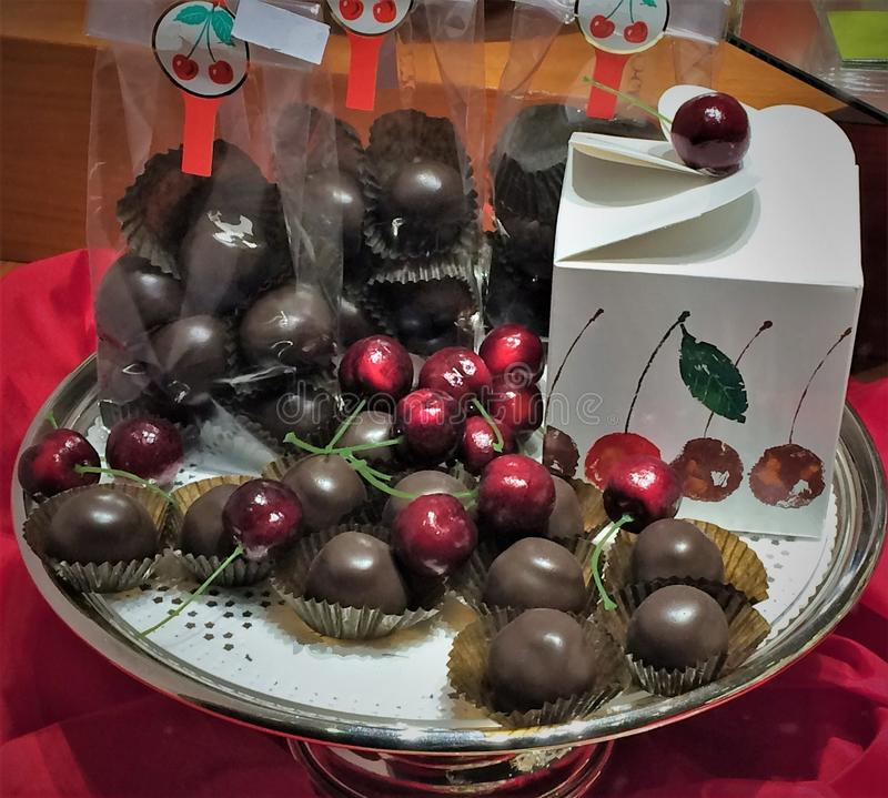 Cherry covered with chocolate on a plate. royalty free stock photo