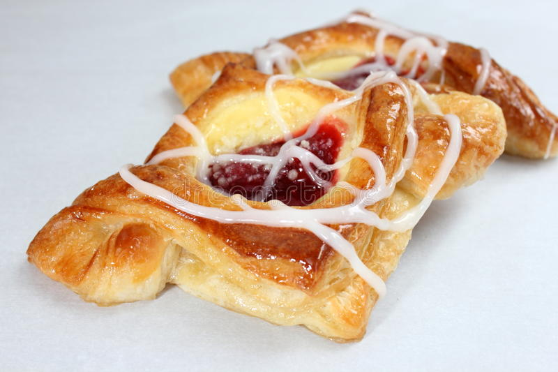 Cherry and cream pastry. On a white background stock photo