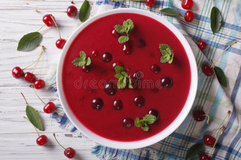 Cherry cream soup with mint close-up. Horizontal top view stock photo