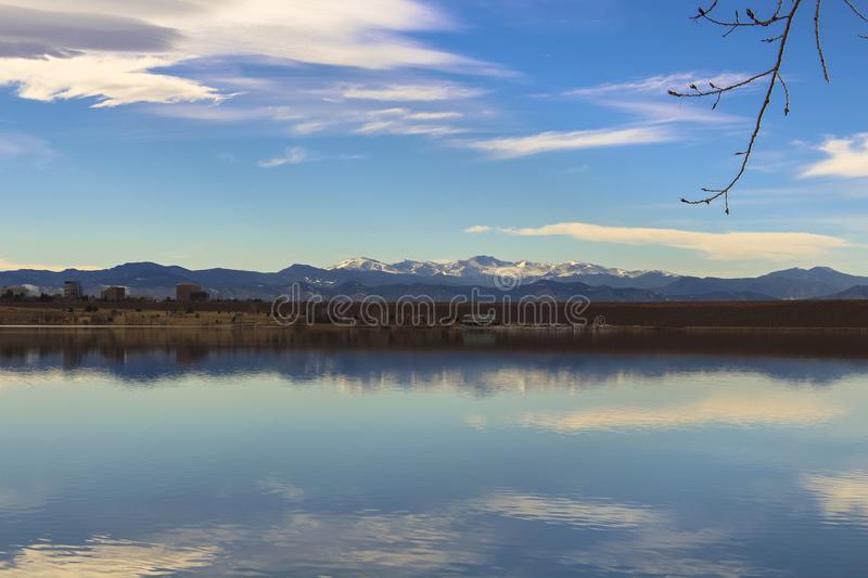 Cherry Creek Reservoir. In Aurora, Colorado at Cherry Creek State Park. Mt. Evans is in the background and the clouds are reflecting on to the lake royalty free stock image
