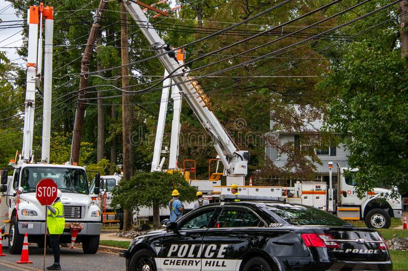 Utility crews repairing fallen electric wires and poles after a strong storm caused extensive damage in this township. Cherry Hill, New Jersey - September 30 stock images