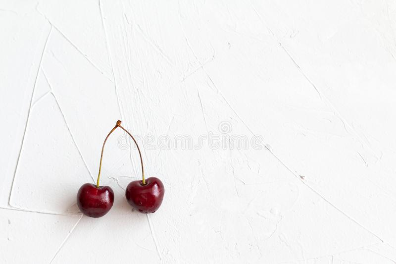 Cherry isolated on grey background, space for text, top view and horizontal orientation. Cherry isolated on grey background, space for text, flat lay and stock images