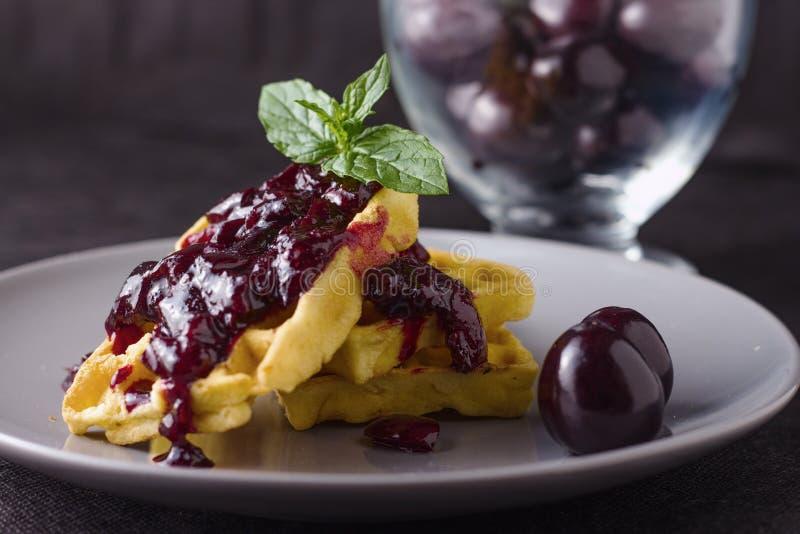 Cherry jam waffles stock photos