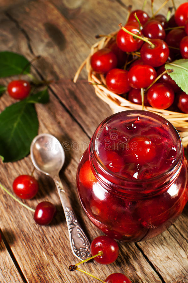 Cherry jam on a wooden background royalty free stock images