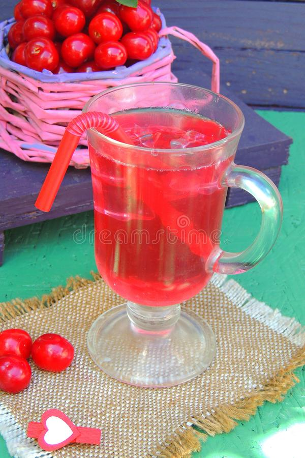Cherry juice with ice stock images