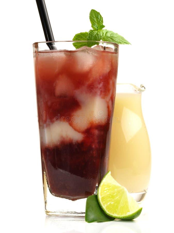 Cherry Juice met Banaansap op witte Achtergrond royalty-vrije stock foto's