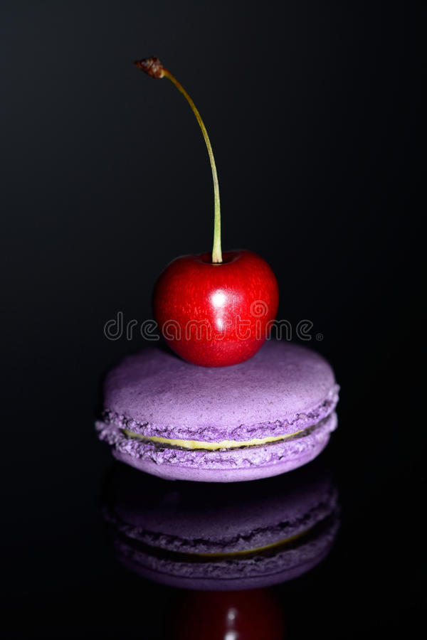 Cherry On A Macaroon Stock Photo