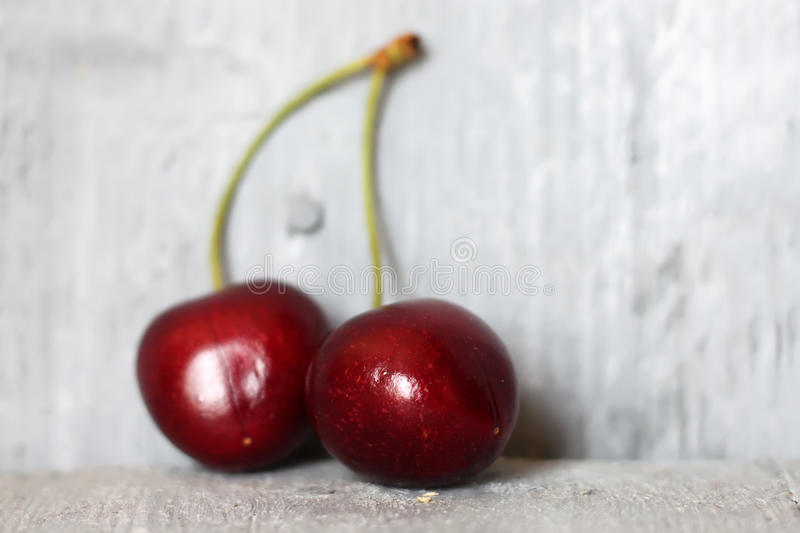 Cherry. Photo of ripe cherries on wooden background stock photography