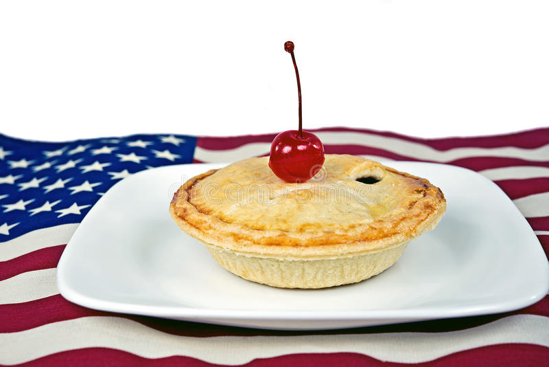 Cherry pie on a American flag royalty free stock photography