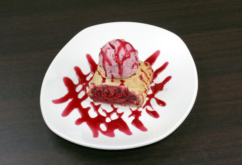 Cherry pie with icecream. And syrup stock photo