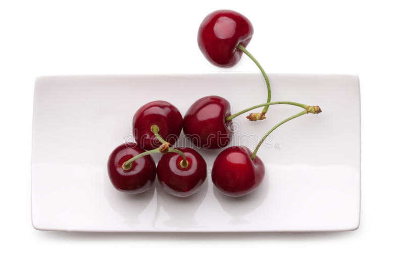 Cherry on a plate stock images