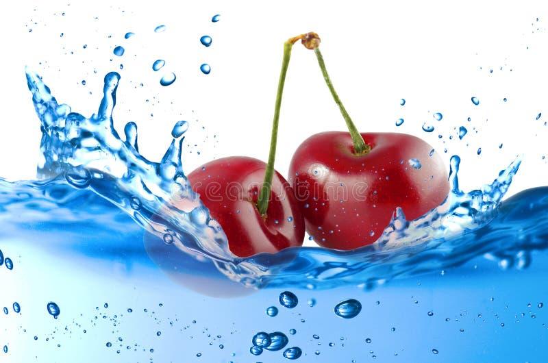 Cherry splash royalty free stock photos