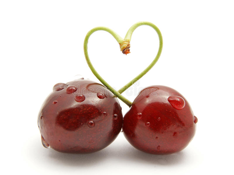 Cherry stick heart-shape stock photography