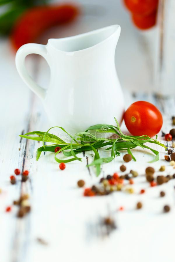 Cherry, tarragon, chili pepper, basil, spices Ingredients for cooking pasta. Food background on a white table royalty free stock photography