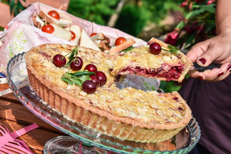 Cherry tart slice with almonds royalty free stock images