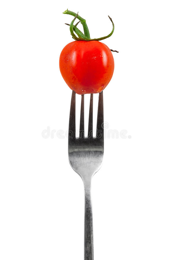 Cherry tomato on a fork royalty free stock images