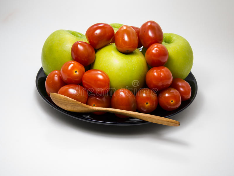 Cherry Tomato and Green Apple royalty free stock photography