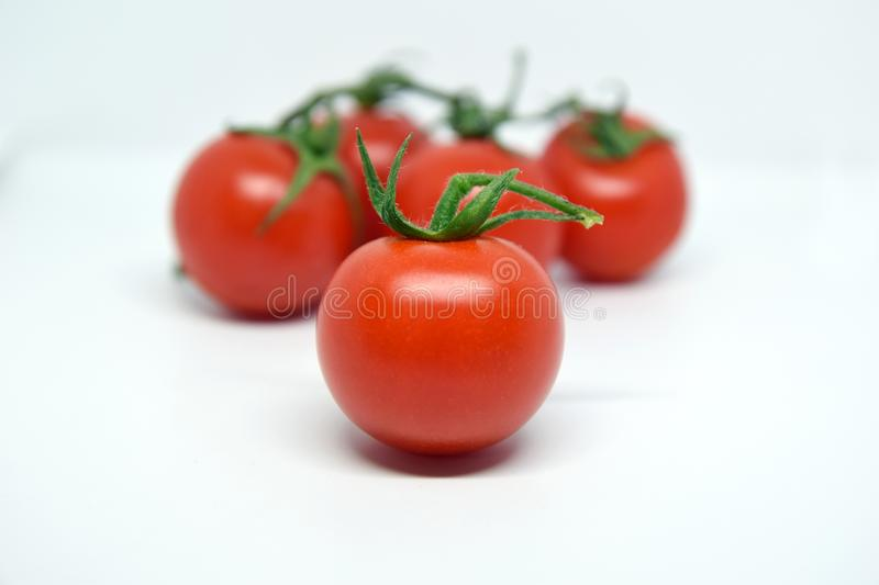 4 Cherry tomato with green handle stock image