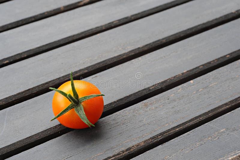Cherry tomato on a wooden table stock photos