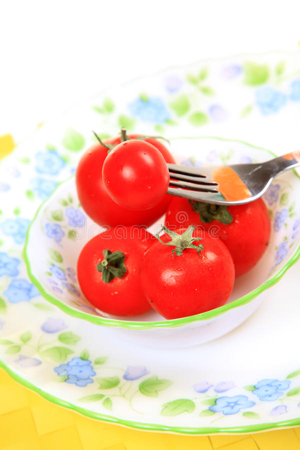 Download Cherry tomatoes stock photo. Image of background, fork - 24685568