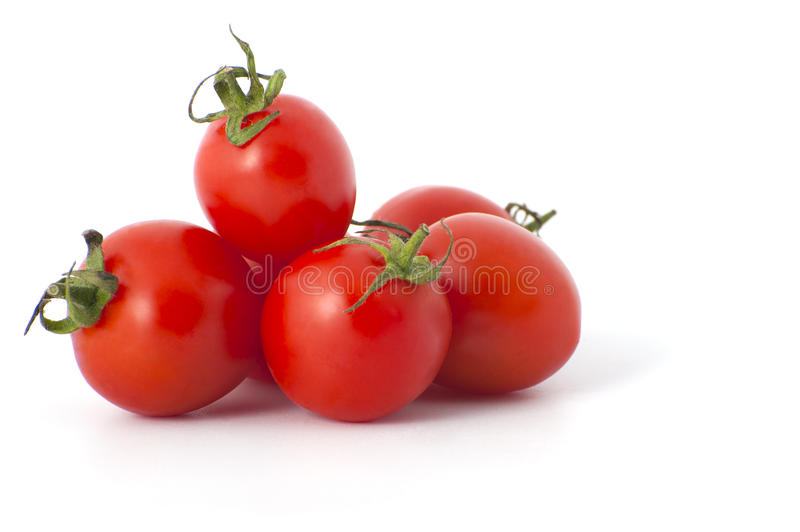Cherry tomatoes close-up. Studio photography on a white background. Six varieties of tomatoes cherry on a white background royalty free stock image