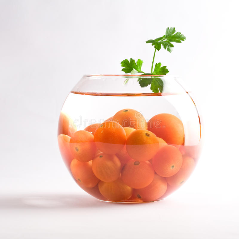Download Cherry Tomatoes In A Glass Aquarium Stock Photo - Image: 12974322