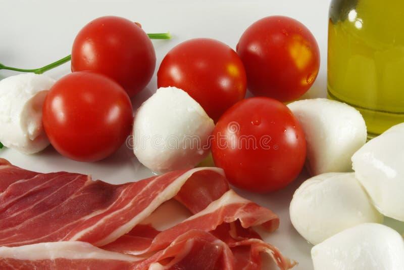 Cherry tomatoes, ham and mozzarella, royalty free stock photography