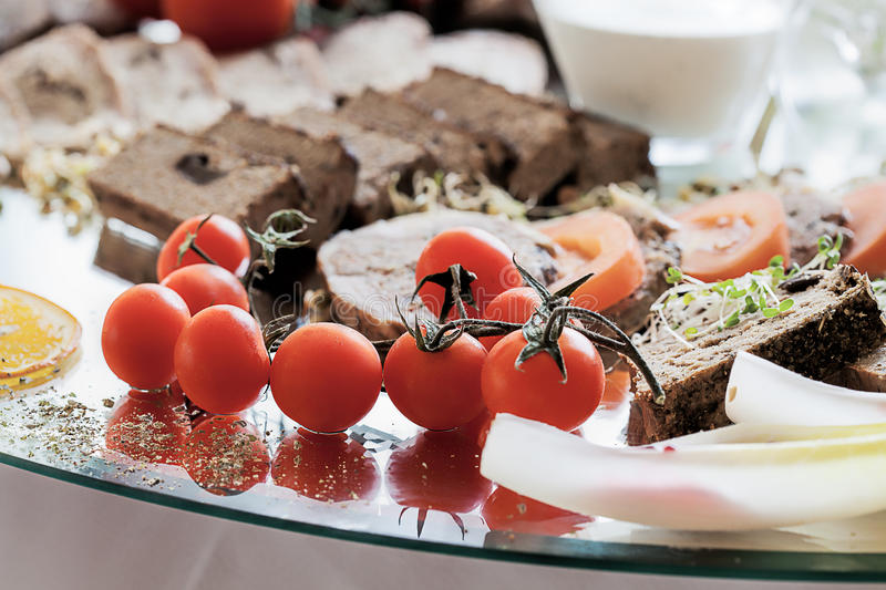 Cherry tomatoes and sliced meat royalty free stock photo