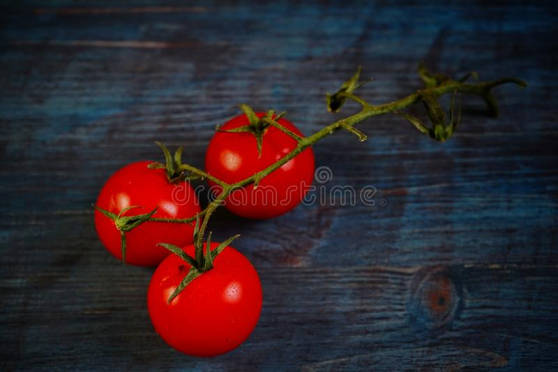 Download Cherry tomatoes stock image. Image of tomatoes, wooden - 83720497