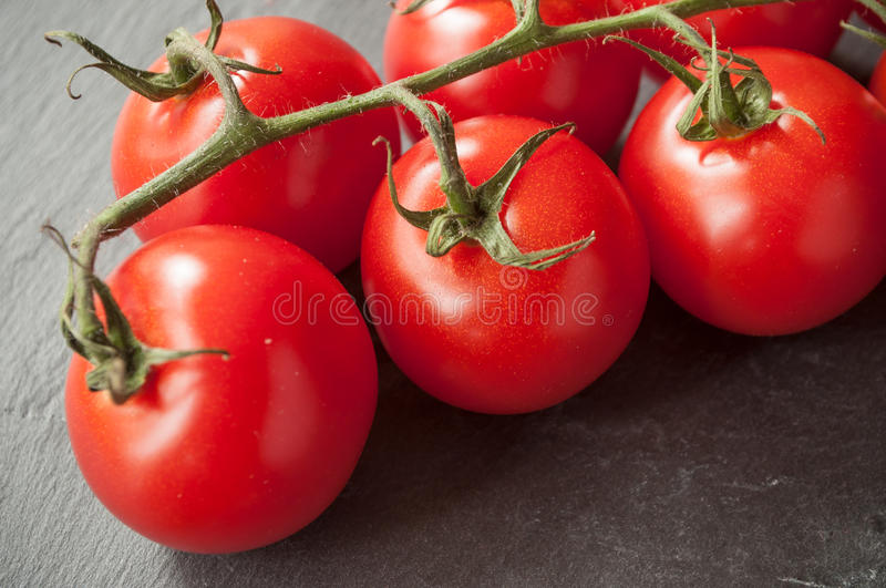 Download Cherry Tomatoes On Wooden Background Stock Photo - Image: 83710927