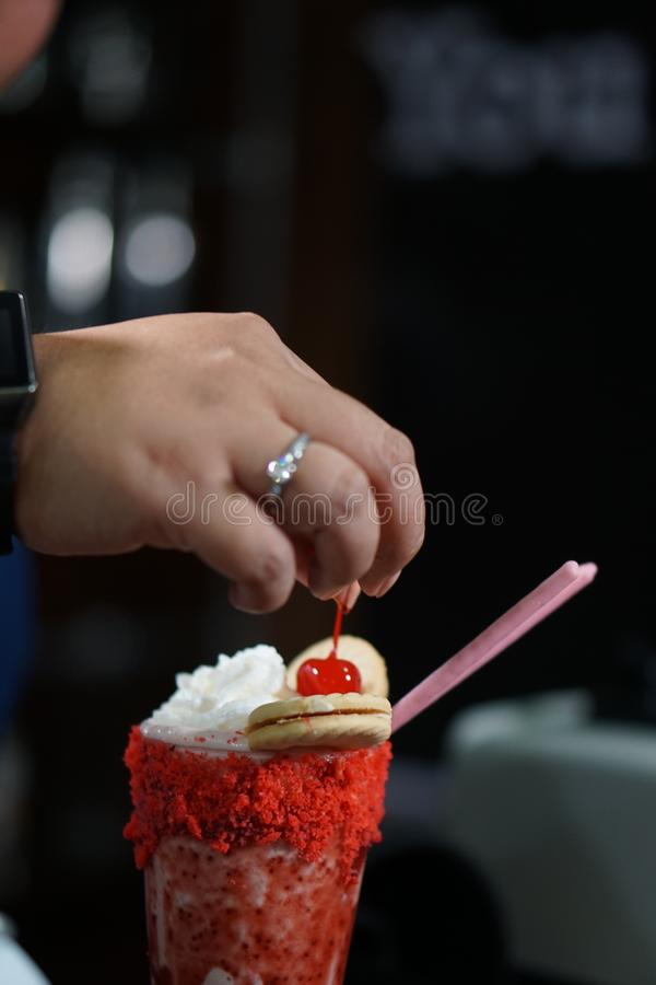 Cherry on top of a milkshake stock photo