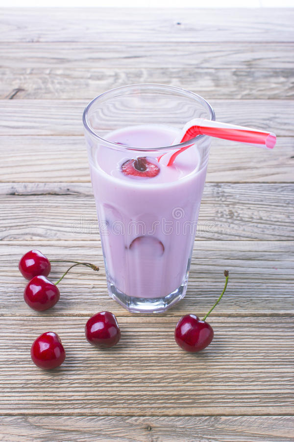 Cherry yogurt in a glass jar on wooden table stock photos