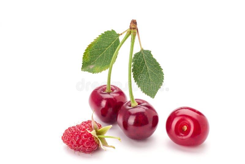 Cherryes i malinka zdjęcia stock