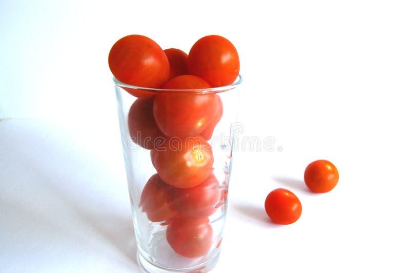 Cherryexponeringsglastomater fotografering för bildbyråer