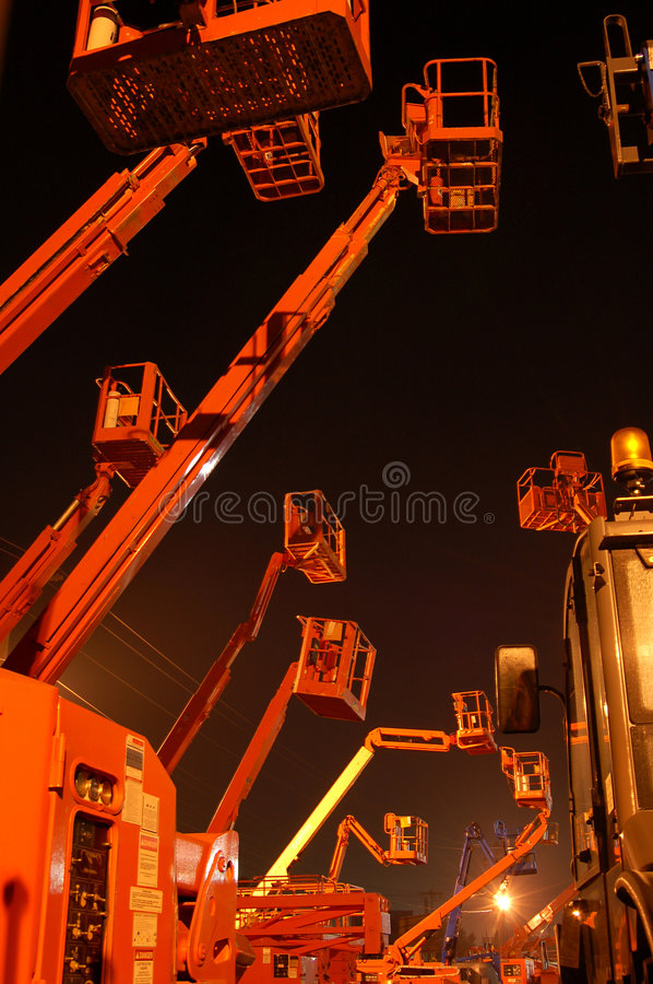 Cherrypickers by night royalty free stock photo