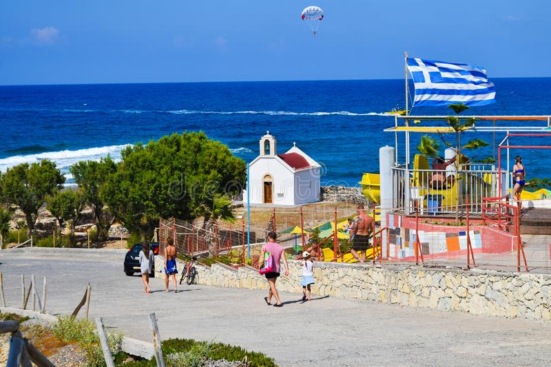 Chersonissos, Greece - June 27, 2015: People go to the beach in summertime royalty free stock photo