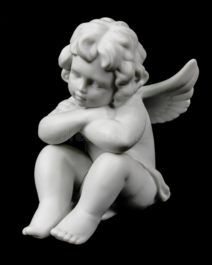 Cherub on black stock photography