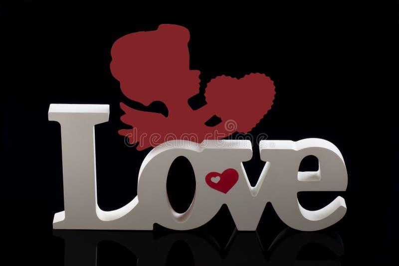 Cherub del biglietto di S. Valentino con cuore fotografia stock libera da diritti