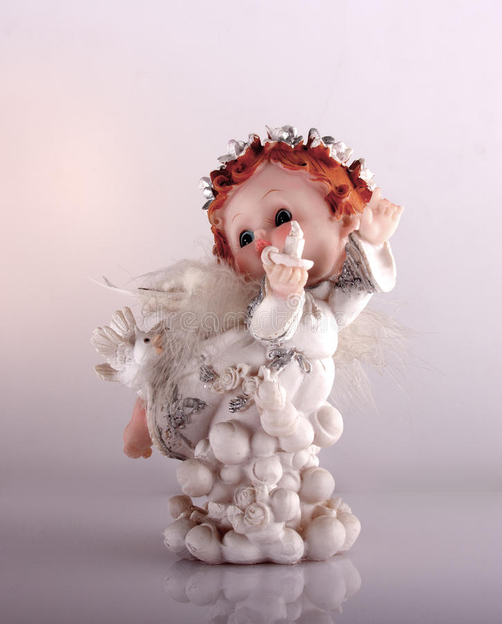Cherub statuette on white royalty free stock photography