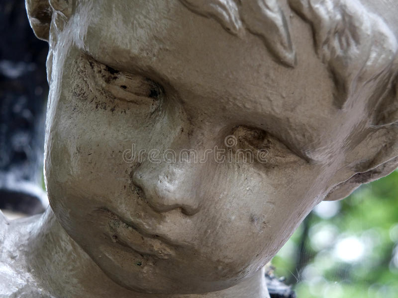 Cherubic face. Close up of cherub face aged sculpture in southport royalty free stock photography