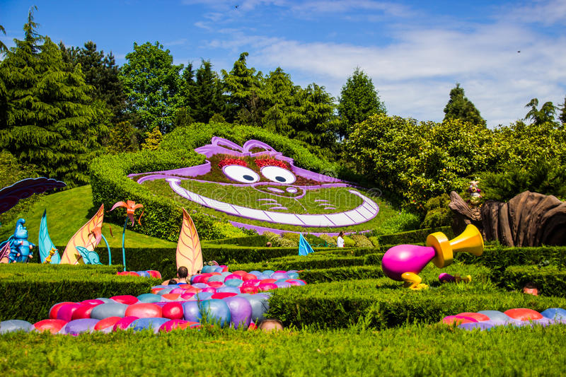 Cheshire cat at the Alice in Wonderland. Alice`s Curious Labyrinth. Disneyland Paris. Cheshire cat at the Alice in Wonderland. Alice`s Curious Labyrinth royalty free stock images