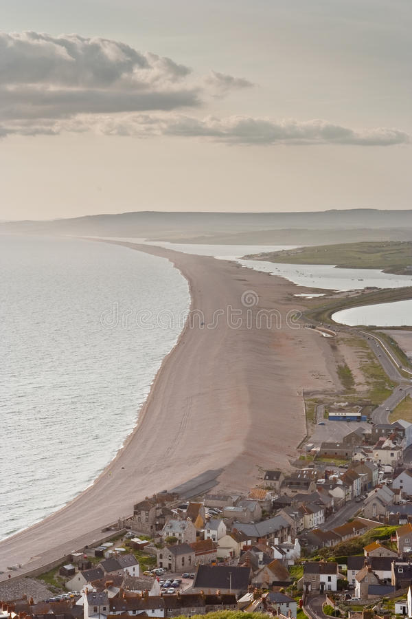 Chesil beach and Abbotsbury. Looking down onto Chesil Beach in Dorset stock photography