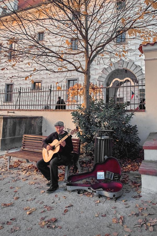 Chesky Krumlov, Czech Republic - July 22, 2018: Man playing guitar in Historic centre of Chesky Krumlov old town in the South royalty free stock photos