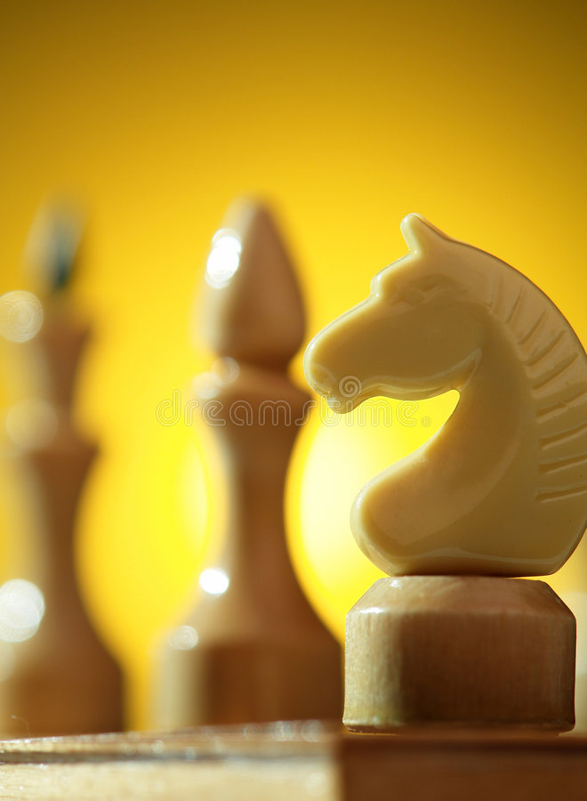 Chess. On a background of a board royalty free stock photo