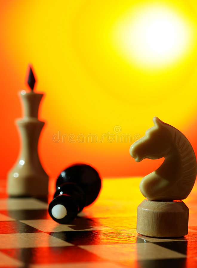Chess. On a background of a board royalty free stock images