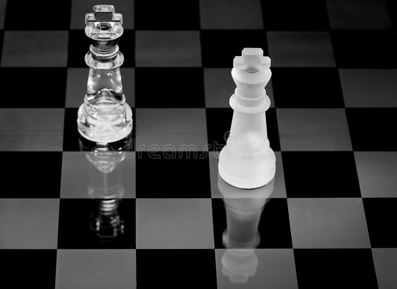 Chess board. Complete with pieces made of glass stock image