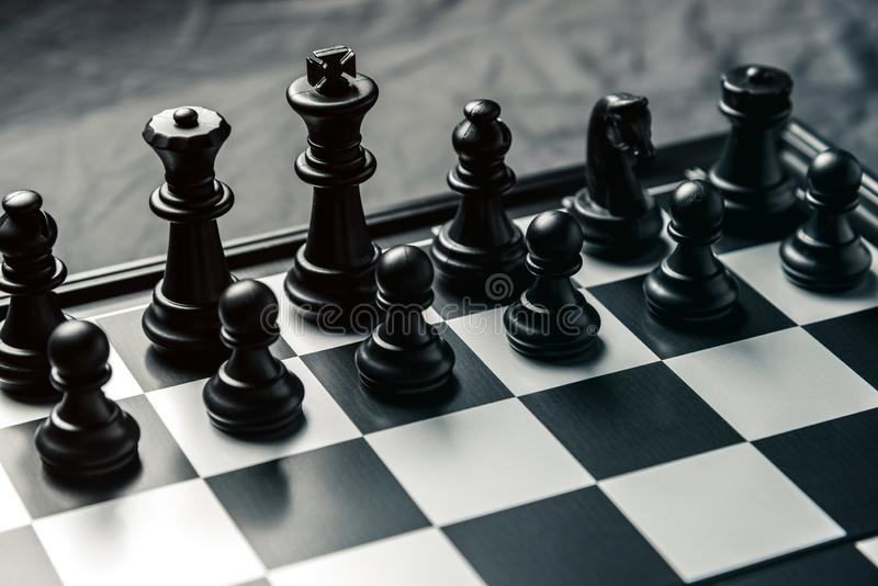 Chess board with black chess in the starting position royalty free stock photo