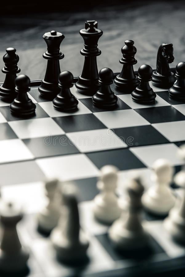 Chess board with black and white chess facing each other stock image