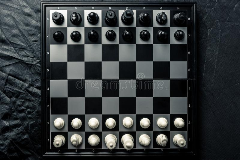 Chess board with black and white chess facing each other royalty free stock photography