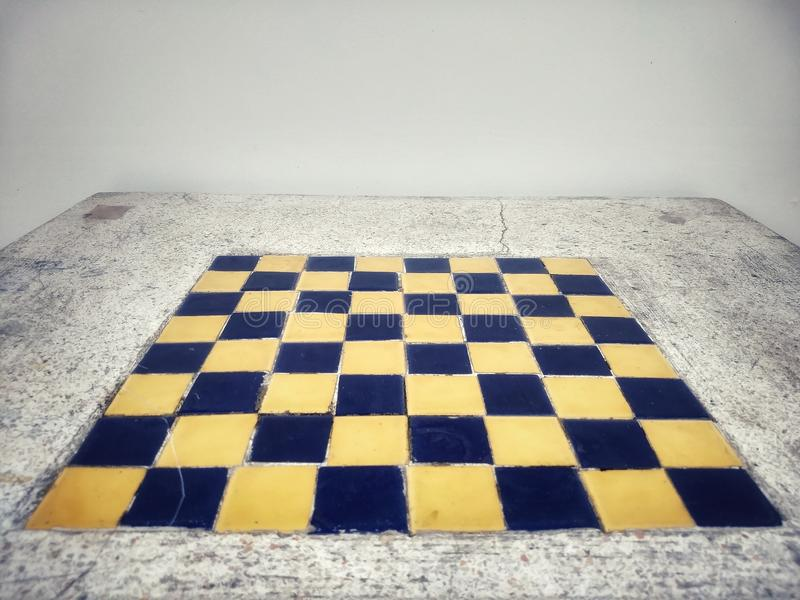 The chess board built in the mable table. stock images
